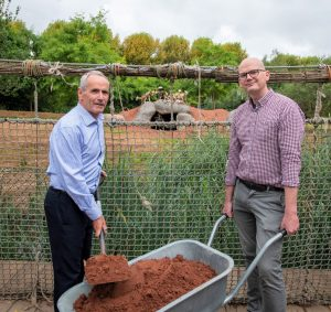 Colin Rankin, Business Development Director for VINCI Construction UK Limited, left and Councillor Richard Beacham, Cabinet Member for Inclusive Growth, Economy and Regeneration at the painted dogs enclosure.