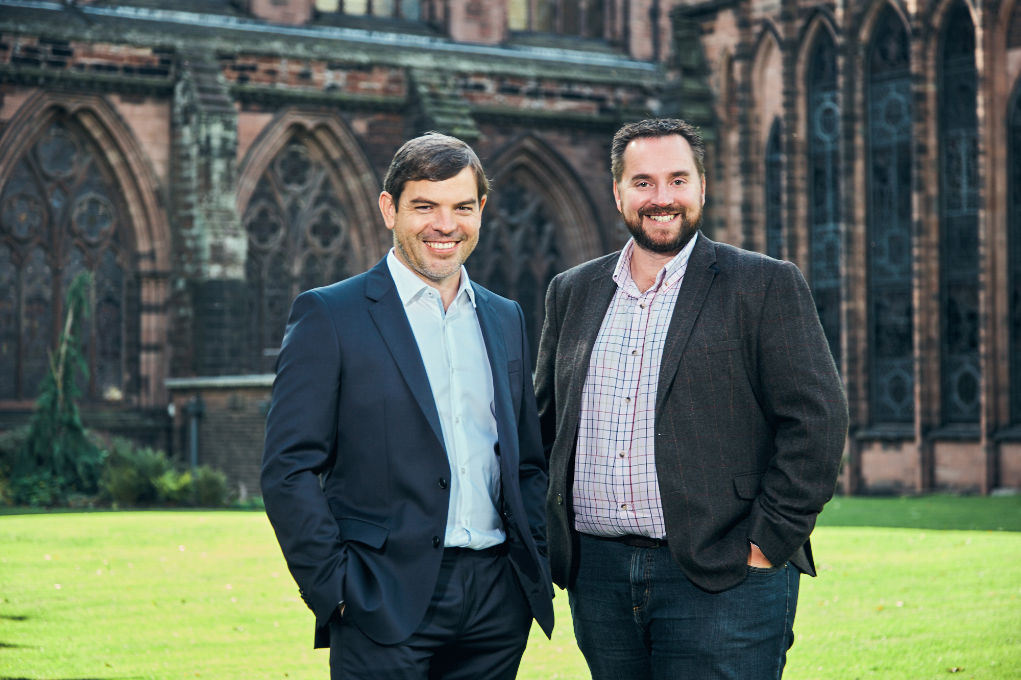 Ken Jones and Gary Melling of Jones Melling, standing outside Chester Cathedral