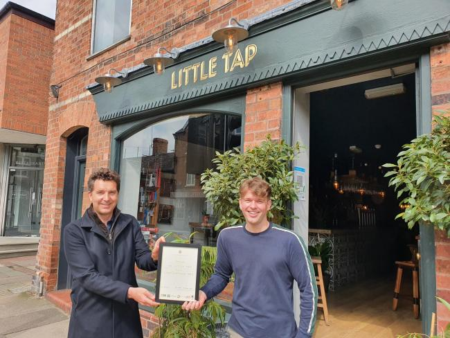 Edward Timpson MP presenting the award to Myles Carr of the Little Tap in Tarporley.